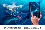 drone or quadcopter with camera ... | Shutterstock .eps vector #1063330175
