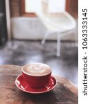 red cup of hot cappuccino in... | Shutterstock . vector #1063333145