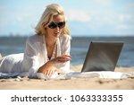 smiling beautiful young woman... | Shutterstock . vector #1063333355