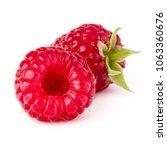 two ripe raspberries isolated... | Shutterstock . vector #1063360676