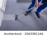 janitor's hand cleaning carpet... | Shutterstock . vector #1063381166