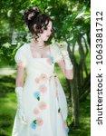 young woman in an elegant long... | Shutterstock . vector #1063381712