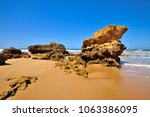 torquay is promoted as the... | Shutterstock . vector #1063386095