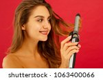 young smiley woman making curly ... | Shutterstock . vector #1063400066