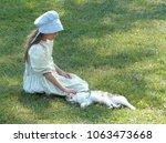Small photo of Mennonite Girl Petting Kitten on Amish Farm