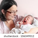 Young mother with her newborn baby. Close up with shallow DOF. - stock photo