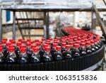bottling factory   black juice... | Shutterstock . vector #1063515836