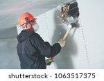 demolition work and... | Shutterstock . vector #1063517375
