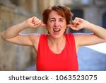 woman in red dress stopping up... | Shutterstock . vector #1063523075