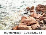 sea with small waves and with... | Shutterstock . vector #1063526765