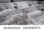 Water Cascading Over Weir Step...