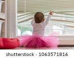 cute little baby girl wearing a ... | Shutterstock . vector #1063571816