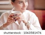 a beautiful woman sits in a... | Shutterstock . vector #1063581476