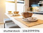 wooden bowl place settings on... | Shutterstock . vector #1063599596