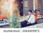 man relaxing in his chair and... | Shutterstock . vector #1063605872