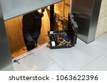 specialist fixing or adjusting...   Shutterstock . vector #1063622396