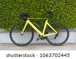 yellow road bicycle on street... | Shutterstock . vector #1063702445
