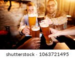 a group of young men clinking... | Shutterstock . vector #1063721495