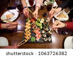 a set of sushi rolls on a table ... | Shutterstock . vector #1063726382
