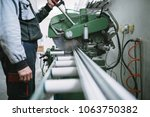 factory for aluminum and pvc... | Shutterstock . vector #1063750382