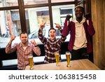 men at the pub watcing football ...   Shutterstock . vector #1063815458