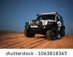 Small photo of Adazi, LV - APR 1, 2016: Jeep Wrangler JK Unlimited Rubicon Recon in desert