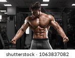 sexy muscular man in gym ... | Shutterstock . vector #1063837082