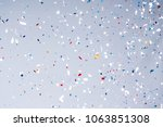 confetti party on background.... | Shutterstock . vector #1063851308