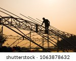 silhouette labor on the roof | Shutterstock . vector #1063878632