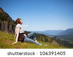 woman sits at the top of a... | Shutterstock . vector #106391405