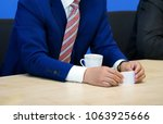 businessman with business card... | Shutterstock . vector #1063925666