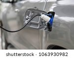charging an electric car with... | Shutterstock . vector #1063930982