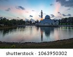 beautiful white mosque by the... | Shutterstock . vector #1063950302