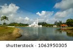 beautiful white mosque by the... | Shutterstock . vector #1063950305