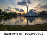 beautiful white mosque by the... | Shutterstock . vector #1063950308