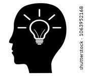 light bulb in a person's head ... | Shutterstock . vector #1063952168