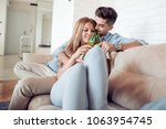 young couple sitting on the... | Shutterstock . vector #1063954745