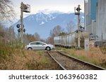 a small car crosses a single... | Shutterstock . vector #1063960382