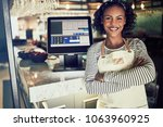 young african waitress wearing... | Shutterstock . vector #1063960925