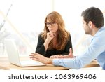young financial assistant... | Shutterstock . vector #1063969406