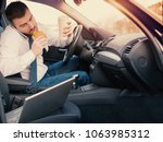 man eating an hamburger and... | Shutterstock . vector #1063985312