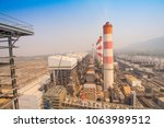 chimneys of coal fired power... | Shutterstock . vector #1063989512