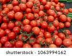 red tomatoes in a supermarket... | Shutterstock . vector #1063994162