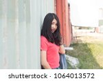 fashion model with long hair... | Shutterstock . vector #1064013572