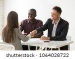 smiling multiracial hr... | Shutterstock . vector #1064028722
