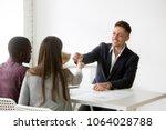 happy interracial family couple ... | Shutterstock . vector #1064028788