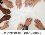 hands of african and caucasian... | Shutterstock . vector #1064028818