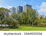skyline view from lumpini park  ... | Shutterstock . vector #1064033336