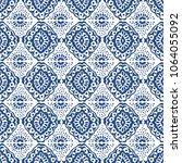 ikat seamless pattern. vector...   Shutterstock .eps vector #1064055092