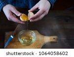 separated eggs over dark brown... | Shutterstock . vector #1064058602